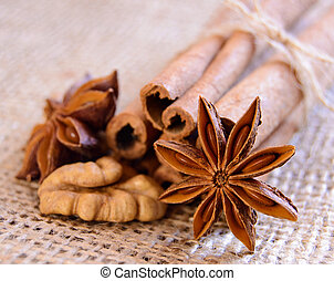 Walnuts, Star Anise and Cinnamon on the Burlap Background