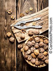 Walnuts with Nutcracker on the Board.