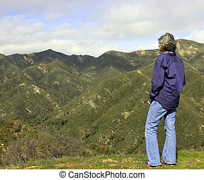 waman on a moutain overlook