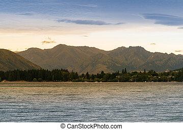 Wanaka lake with mountain background sunset tone