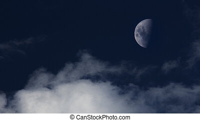 Waning moon - Moon in a waning quarter stands out against...