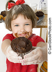 Want A Muffin? - Beautiful four year old girl handing...