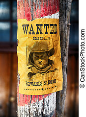 wanted farwest - vintage wanted poster in a gost town