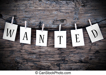 Wanted on Wooden Background