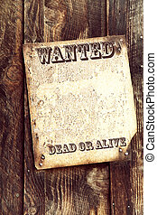 Wanted poster - Old wood background with faded wanted poster...