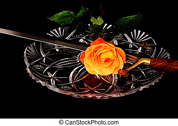 War and Peace - Sword and rose on crystal symbolizing war...