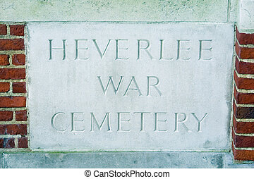 War cemetery sign - Chiseled stone inscription plate at the...