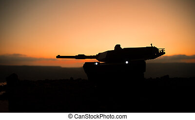 War Concept. Armored vehicle silhouette fighting scene on war fog sky background. American tank at sunset.