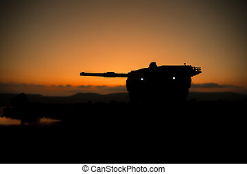 War Concept. Armored vehicle silhouette fighting scene on war fog sky background. American tank at sunset. Creative decoration