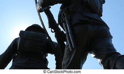 War Memorial. - World War I memorial in silhouette with sun...