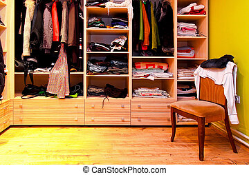 Wardrobe chair - Corner of built in wardrobe with open...
