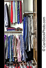 wardrobe of a man with ties and casual dressings