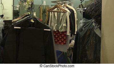 Wardrobe of clothes - A medium shot of a rdrobe of clothes.,