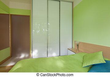 Wardrobe with glass door in bedroom