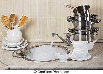 Washing kitchen ware on the sink
