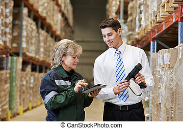 warehouse crew at work - manager and worker in warehouse ...