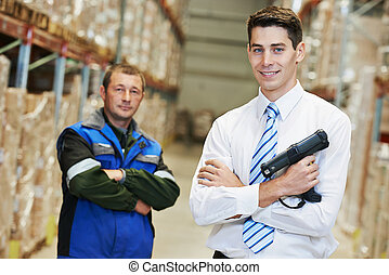 warehouse crew - smiling manager and worker in warehouse...