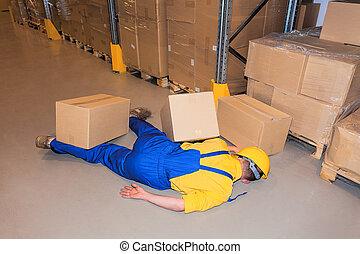 Warehouse danger - Accident in work- worker under carton...
