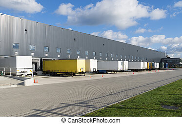 warehouse exterior - exterior of a large warehouse with...