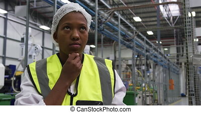 Warehouse female worker using digital tablet