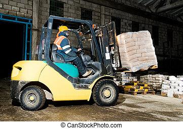warehouse forklift loader works