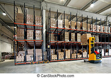 Warehouse forklifter - Yellow fork lifter work in big...