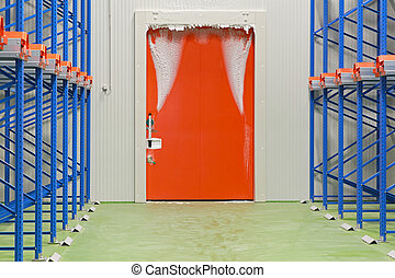 Warehouse freezer door covered in ice and frost