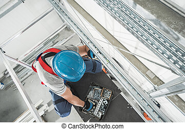 Warehouse Heating and Cooling Systems Technician on Scaffolding