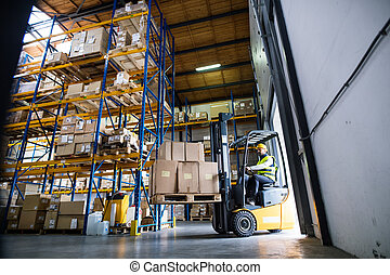 Warehouse man worker with forklift.