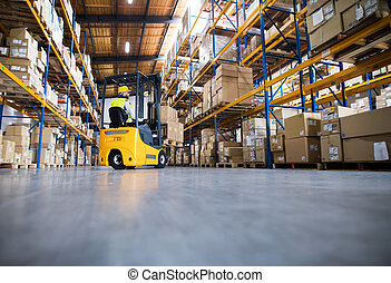 Warehouse man worker with forklift. - Young male worker...