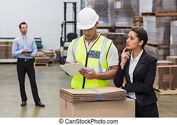 Warehouse manager and worker talking