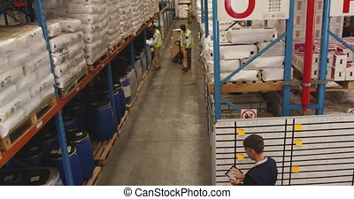 Warehouse manager at an inromation board 4k - Elevated view ...