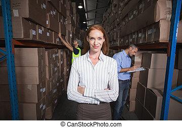 Warehouse manager smiling at camera