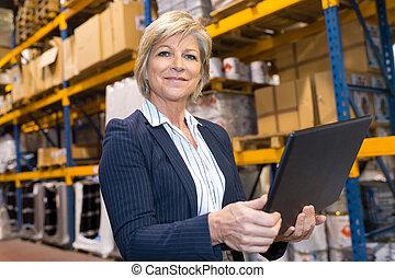 warehouse manager smiling at the camera