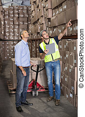 Warehouse manager talking with work