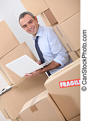 Warehouse manager with boxes