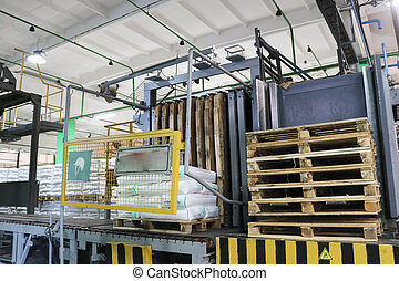 Warehouse of finished products in an industrial enterprise with wooden pallets