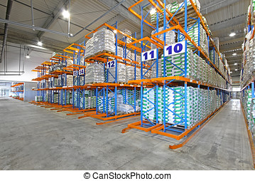 Warehouse - Rows of shelving system in distribution...