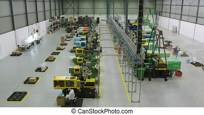 Warehouse staff working together in factory - High angle ...