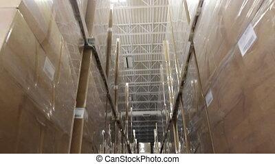 Warehouse Supervisor 3 - A warehouse foreman checks...