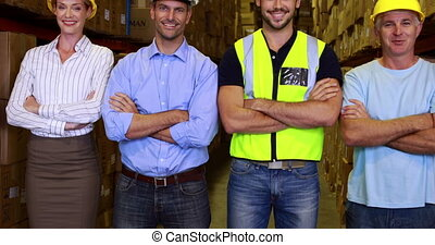 Warehouse team smiling and showing