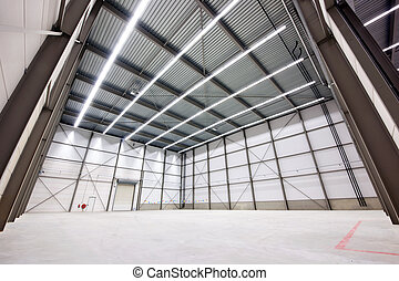 Warehouse to let - large, empty warehouse interior made from...