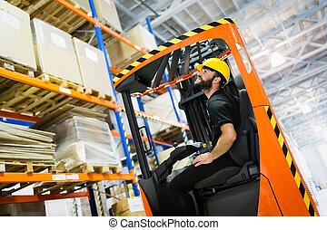 Warehouse worker doing logistics work with forklift loader