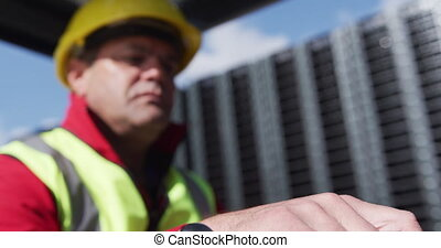 Warehouse worker driving forklift outside factory - Side ...