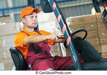 warehouse worker driving forklift