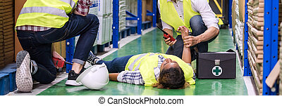 Warehouse worker frist aid after accident panoramic.
