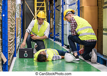 Warehouse worker frist aid after accident.