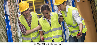 Warehouse worker help colleague first aid after accident panorama