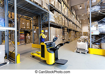 Warehouse worker - Huge metal stillage and yellow hand...