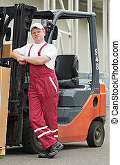 warehouse worker in front of forklift